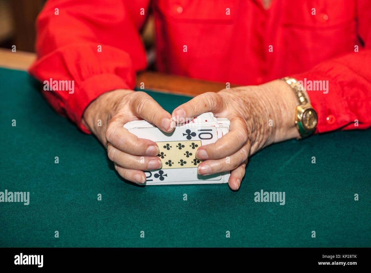 old woman shuffling canasta game cards Stock Photo
