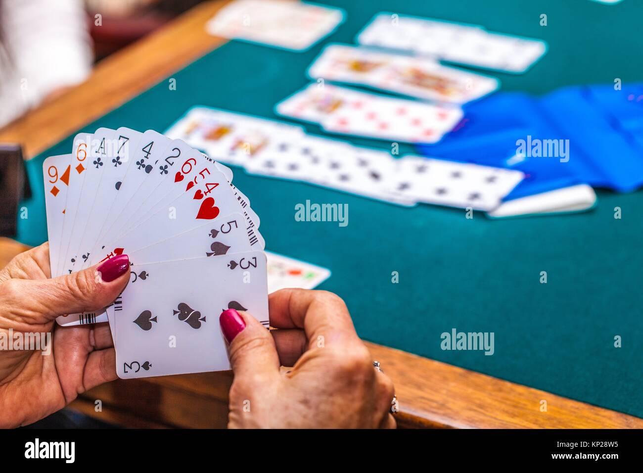 old people playing bridge game Stock Photo
