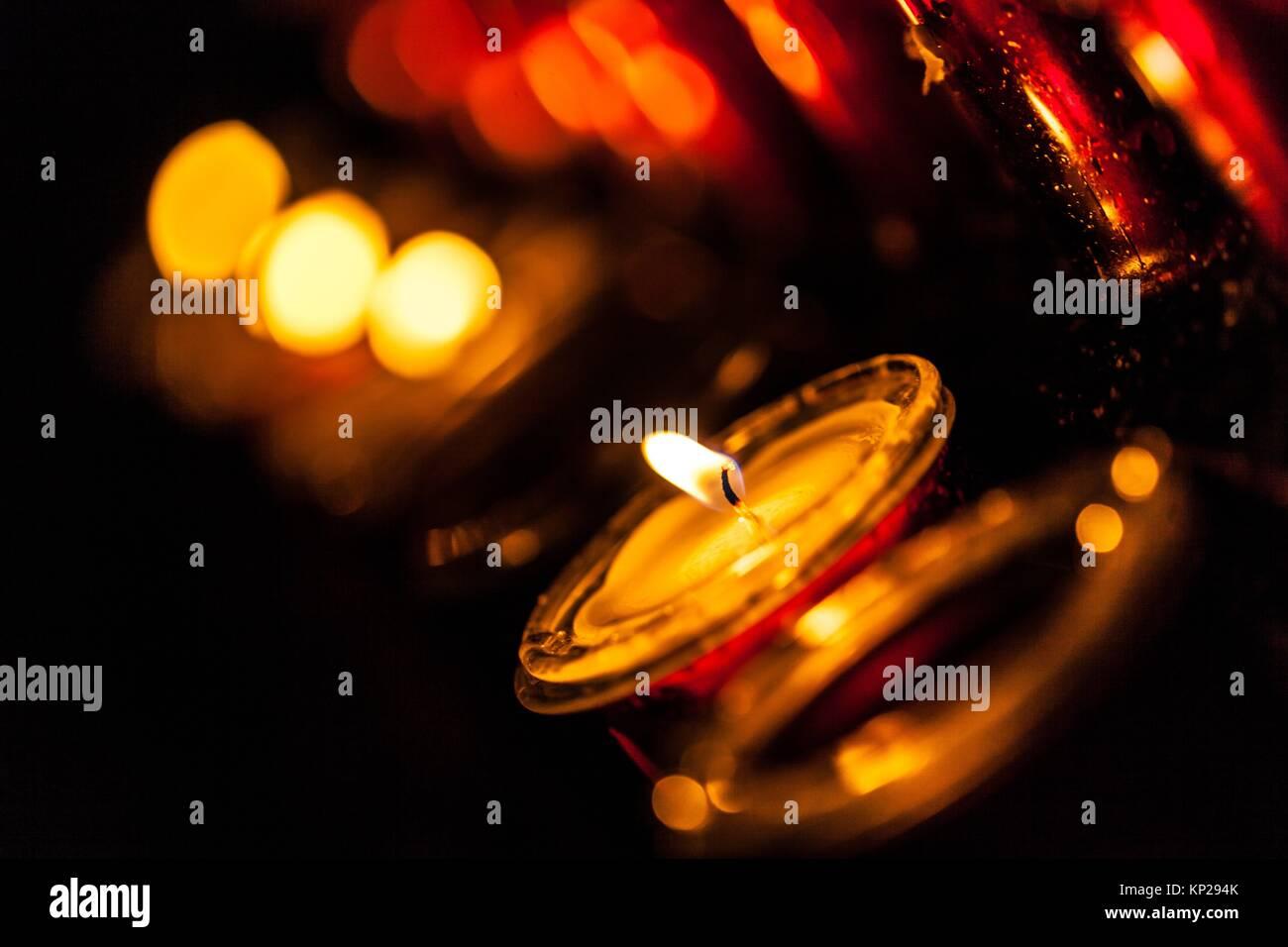 Lit candle set inside a San Cristobal de La Laguna cathedral Stock Photo