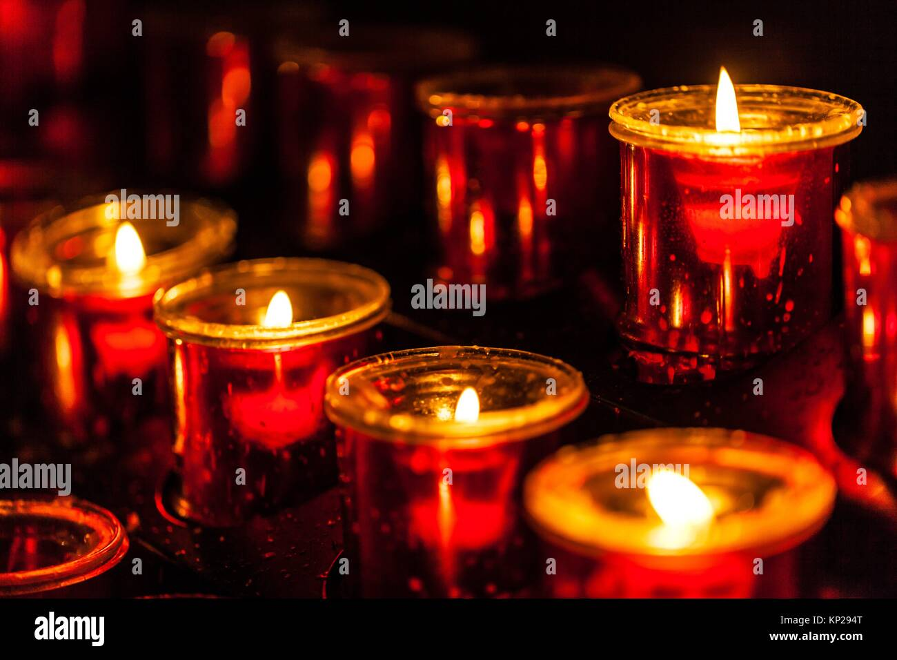 Lit candle set inside a San Cristobal de La Laguna cathedral Stock Photo