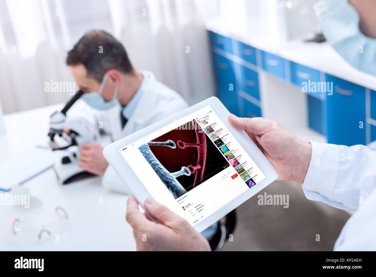 Doctor holding digital tablet - Stock Image