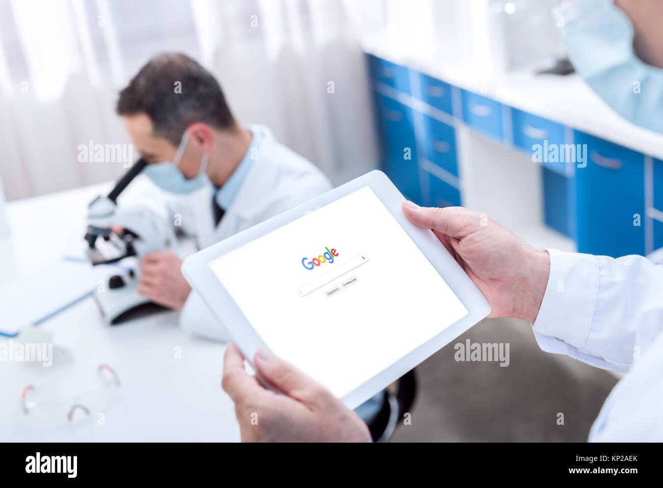 Scientist holding digital tablet - Stock Image