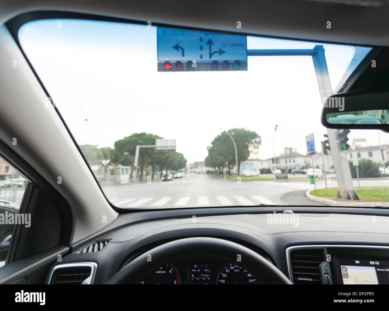 View from inside a car on a part of dashboard with a navigation unit. - Stock Image