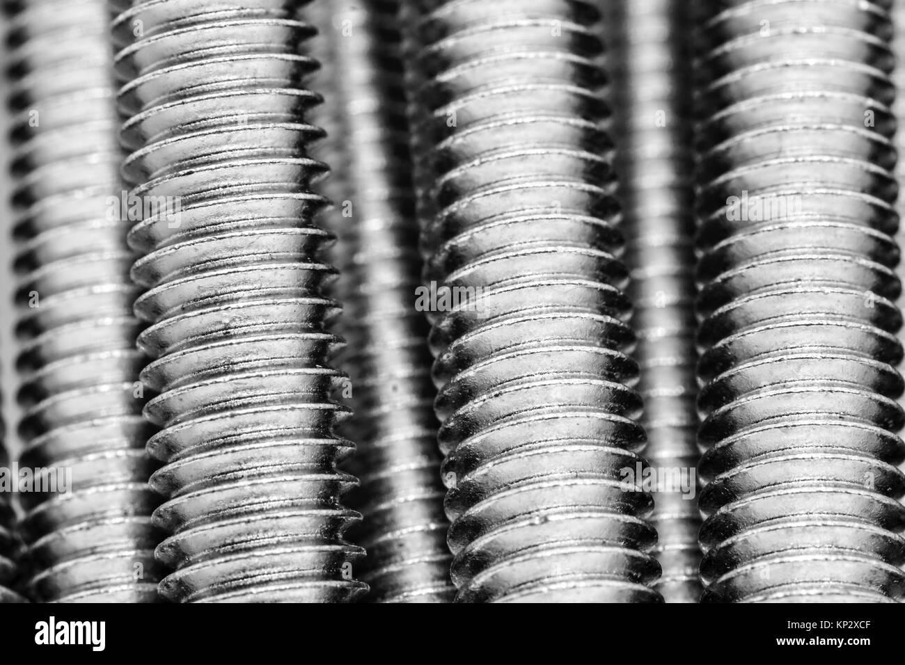Macro of silver screws - Stock Image