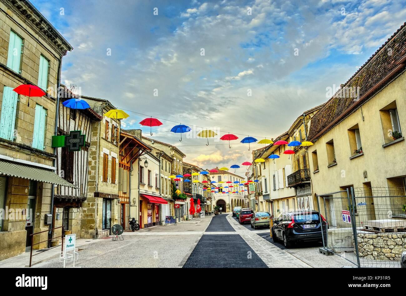 Rue Marcel Herve decorated for annual Gasconnade Festival, Lauzun, Lot-et-Garonne Department, New Aquitaine, France. - Stock Image