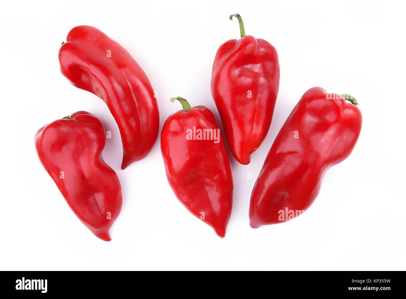 Fifth Peppers in group on white background - Stock Image