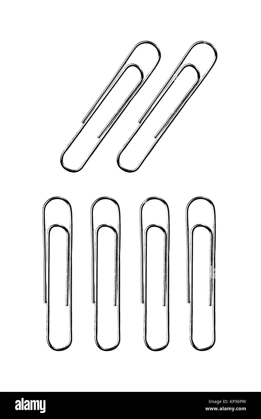 six silver paper clip isolated on white background - Stock Image