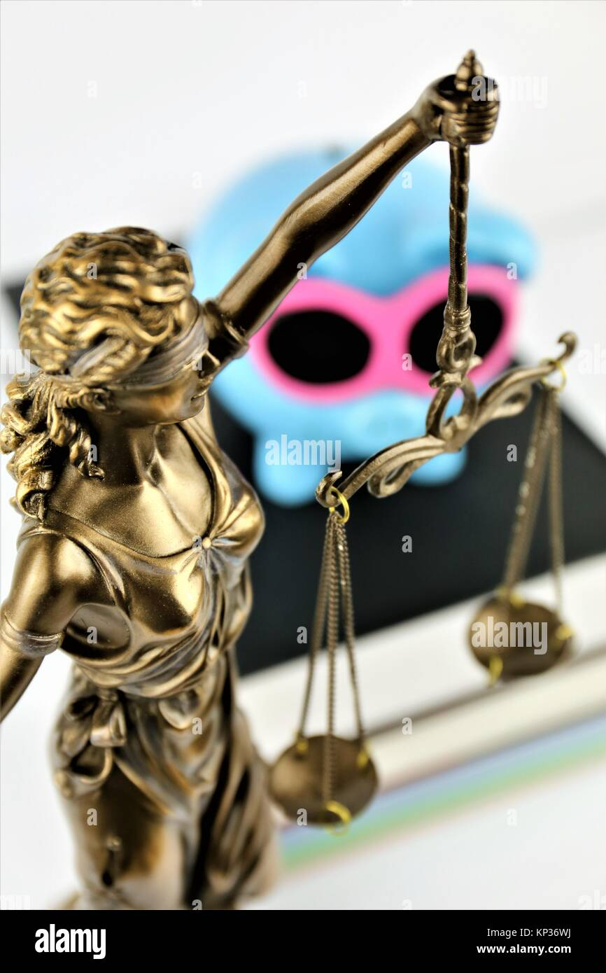 An concept Image of a justice sculpture with books and an piggy - Stock Image