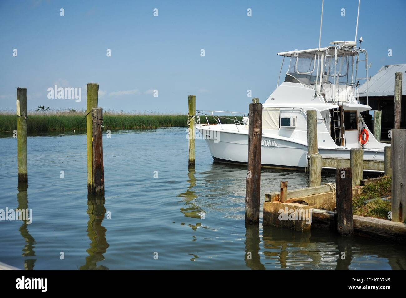 Apalachicola, Florida, Water Street Marina with boat at pier. - Stock Image