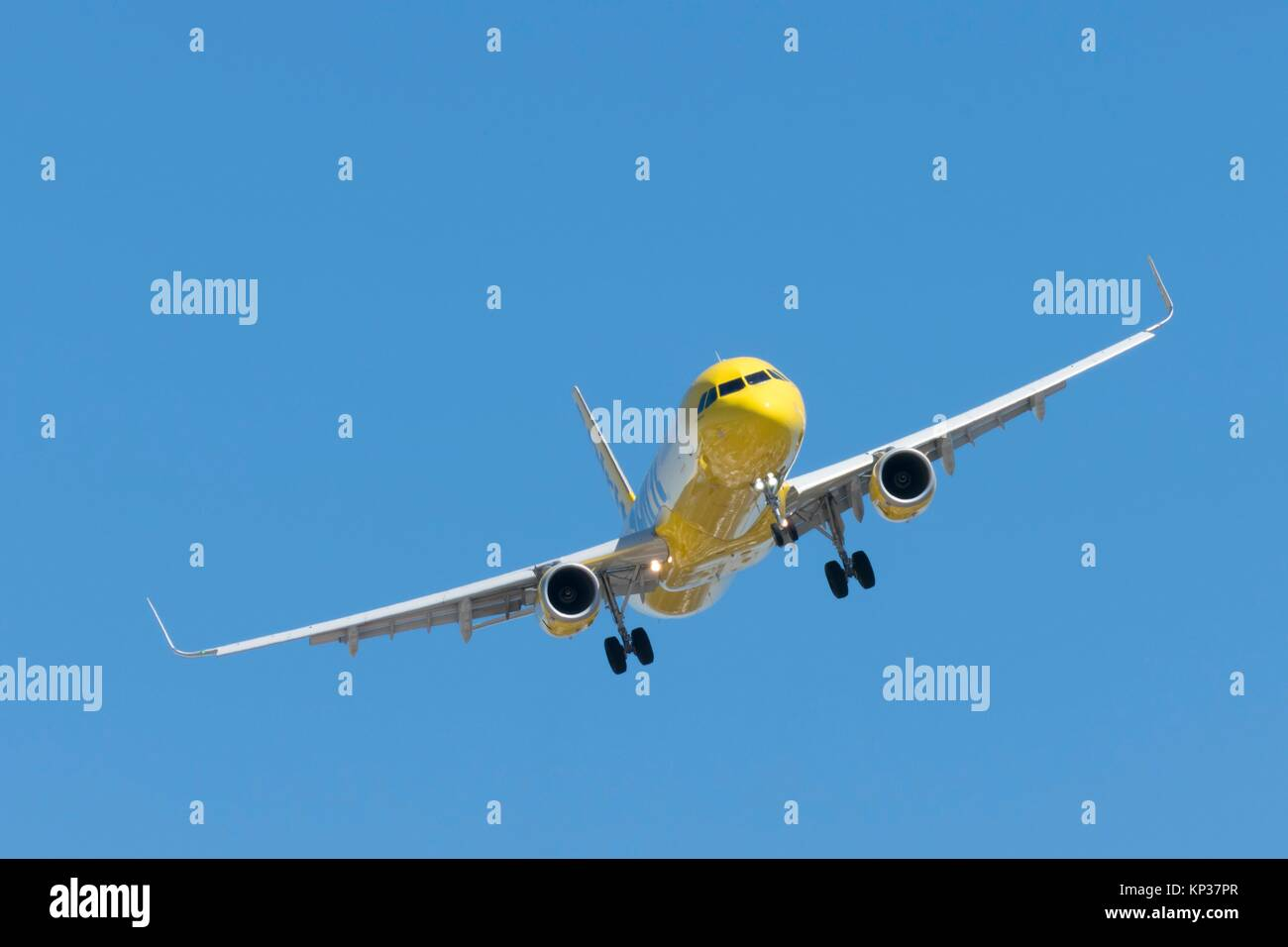 A Jet airplane on final approach to land at San Diego Airport - Stock Image