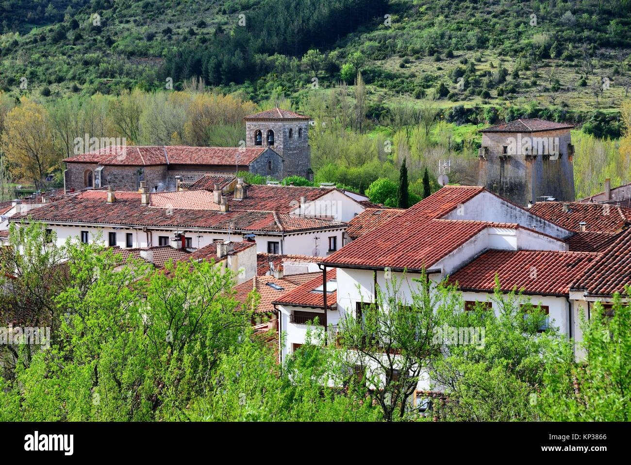 panoramic view of of Covarrubias, in front red roofs of houses, on left bell tower of Collegiate church of Saints - Stock Image