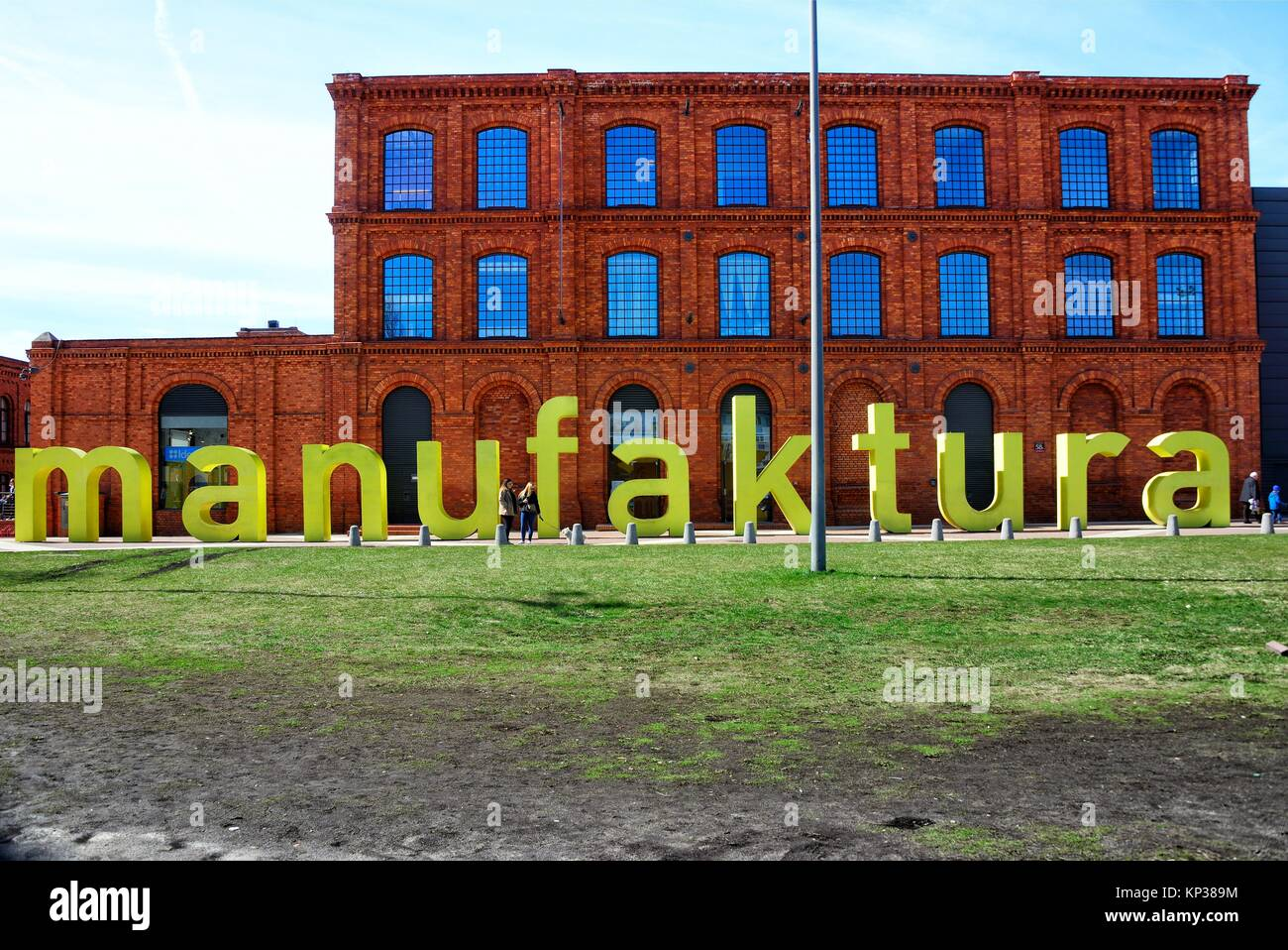 Former, old, historic textile factory after renovation, built in years 1872 - 1892, designed by Hilary Majewski - Stock Image