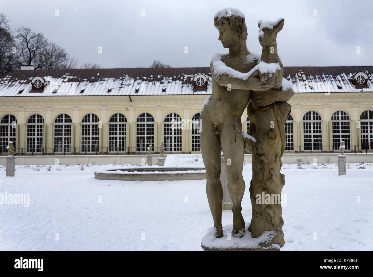 Statues In Front Of Stara Pomaranczarnia Building In Winter