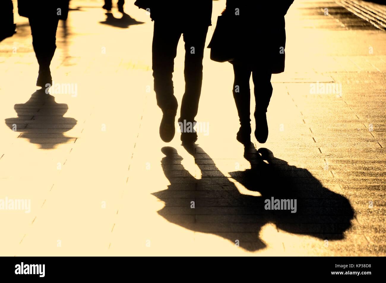 people walking the street, backlit, shadows, Piotrkowska street - main promenade street in Lodz, Lodz, Poland, Europe, - Stock Image