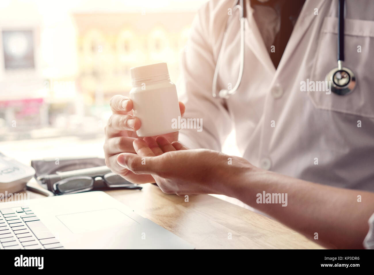 Doctor or physician recommend pills medical prescription to male Patient - Stock Image