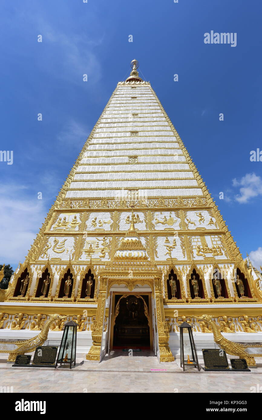 A hive of wild bees can be found on the grounds of the Wat Phra That Nong Bua stupa. - Stock Image