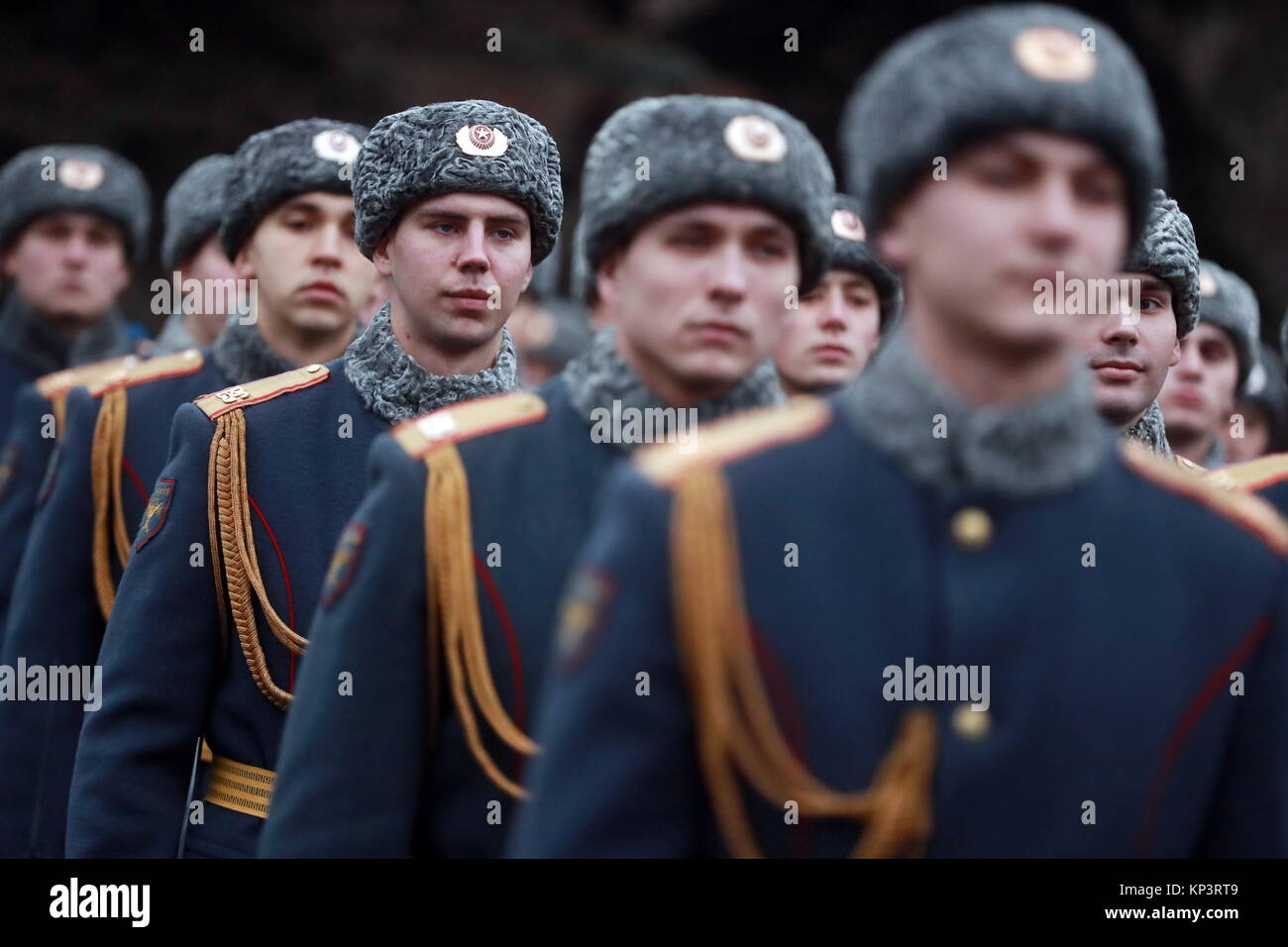 Moscow, Russia. 13th Dec, 2017. Servicemen attend a ceremony to unveil a monument to 'Chernobyl liquidators', - Stock Image