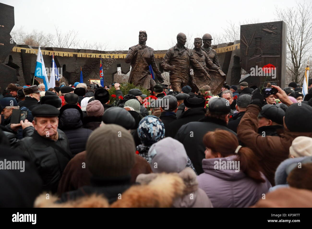 Moscow, Russia. 13th Dec, 2017. People attend a ceremony to unveil a monument to 'Chernobyl liquidators', - Stock Image