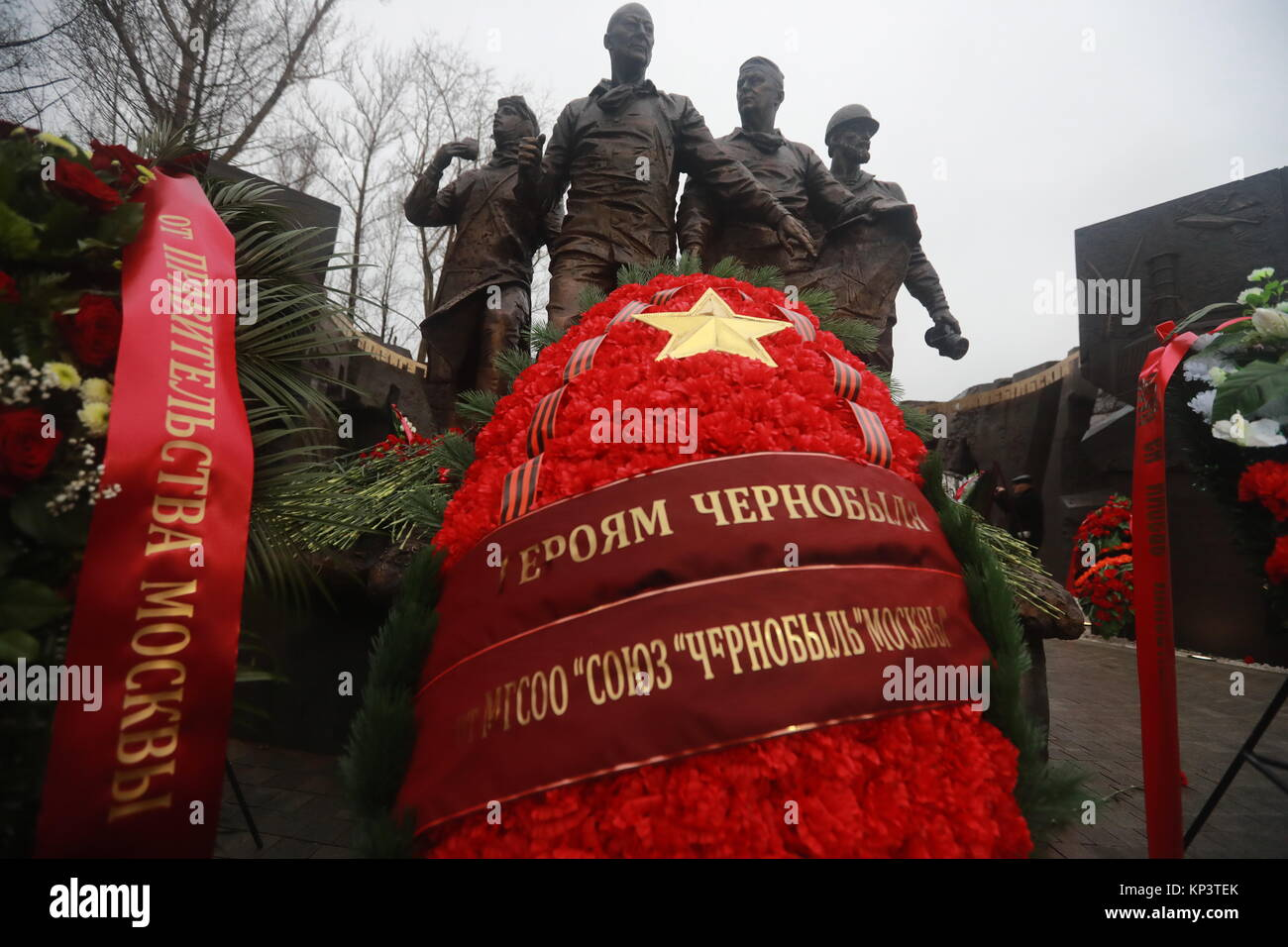Moscow, Russia. 13th Dec, 2017. Wreaths seen by a monument to 'Chernobyl liquidators', people who took part - Stock Image
