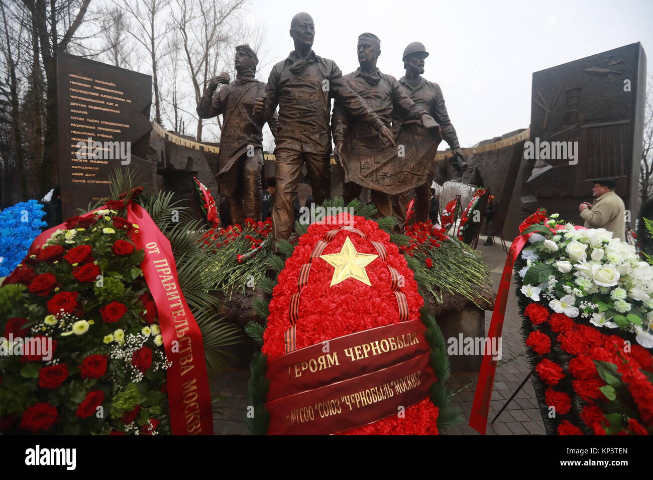 Moscow, Russia. 13th Dec, 2017. Flowers and wreaths seen on a monument to 'Chernobyl liquidators', people - Stock Image