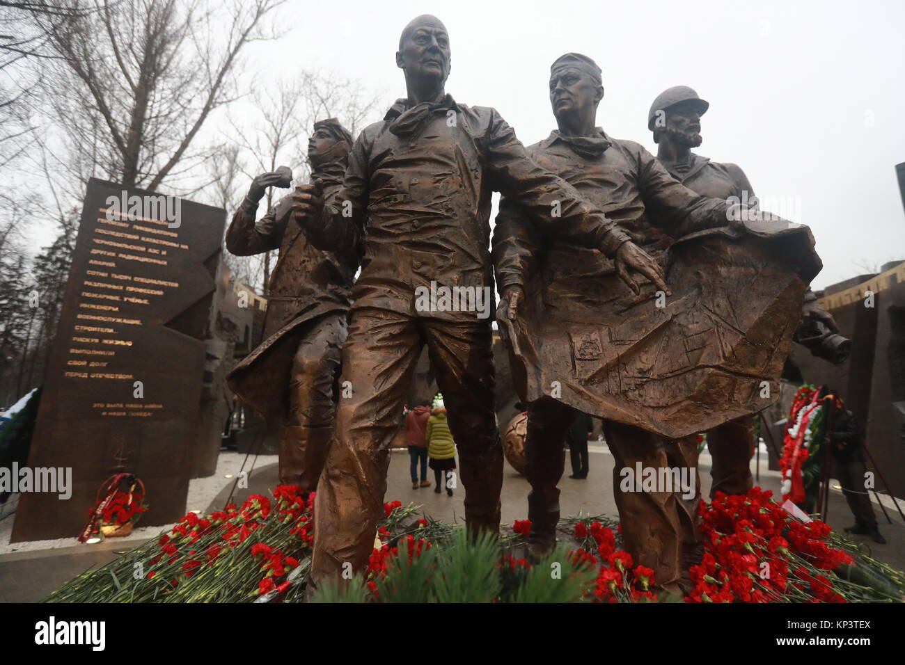 Moscow, Russia. 13th Dec, 2017. Flowers seen on a monument to 'Chernobyl liquidators', people who took part - Stock Image
