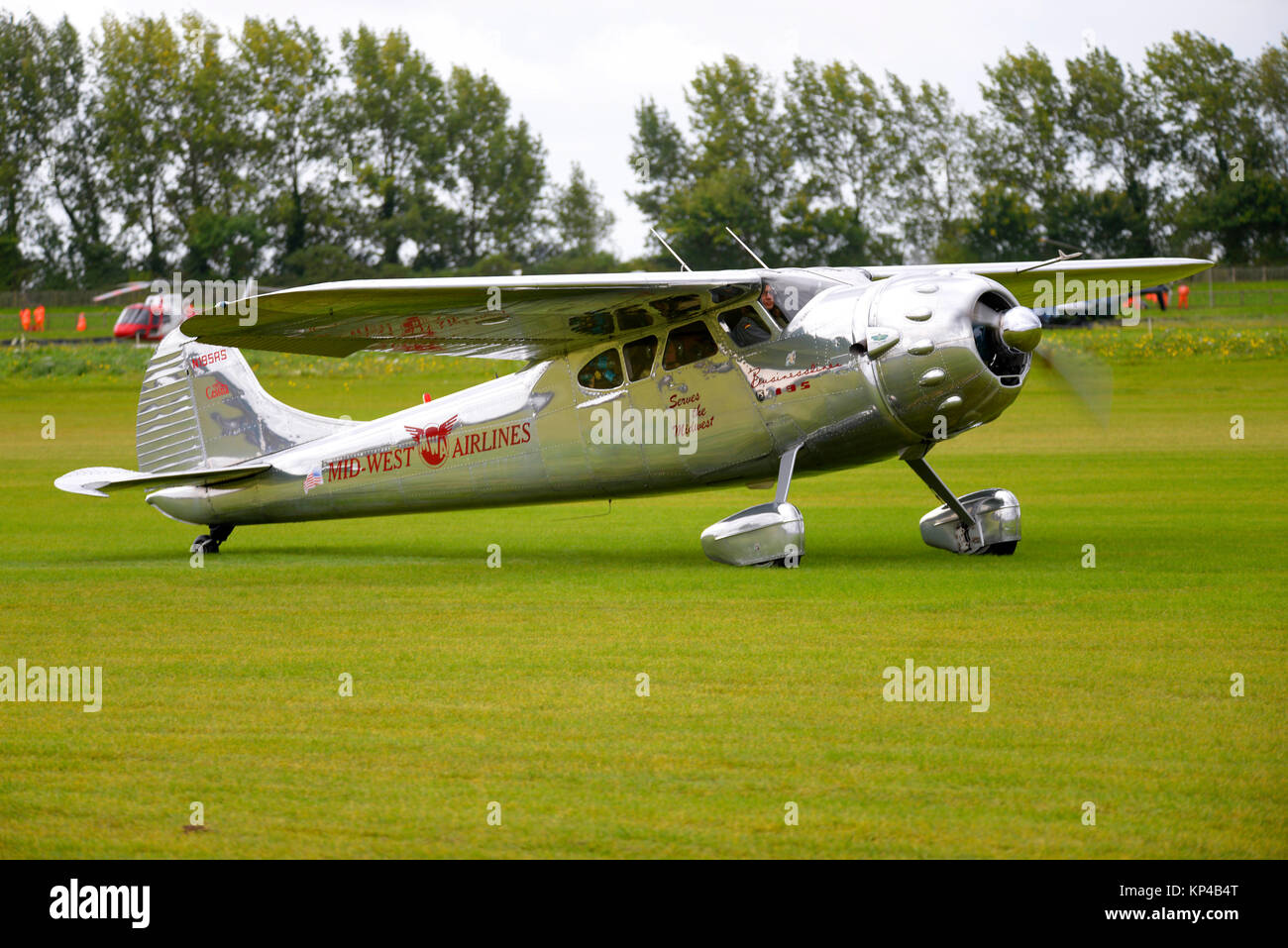 Cessna 195 Businessliner N195RS marked Mid West Airlines taxiing out at Goodwood Revival 2017 - Stock Image