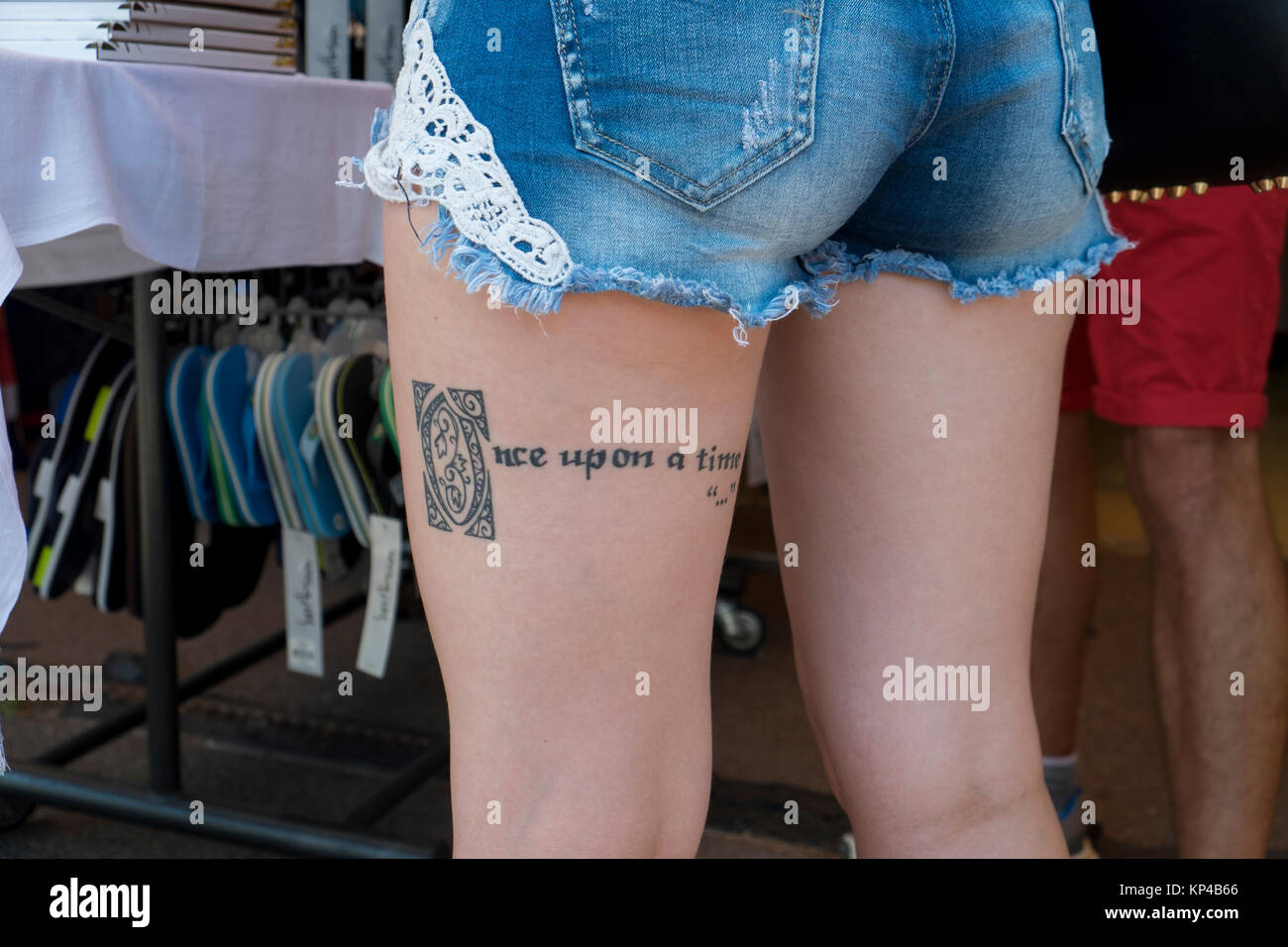 Woman with tattoo on the thigh, France. - Stock Image