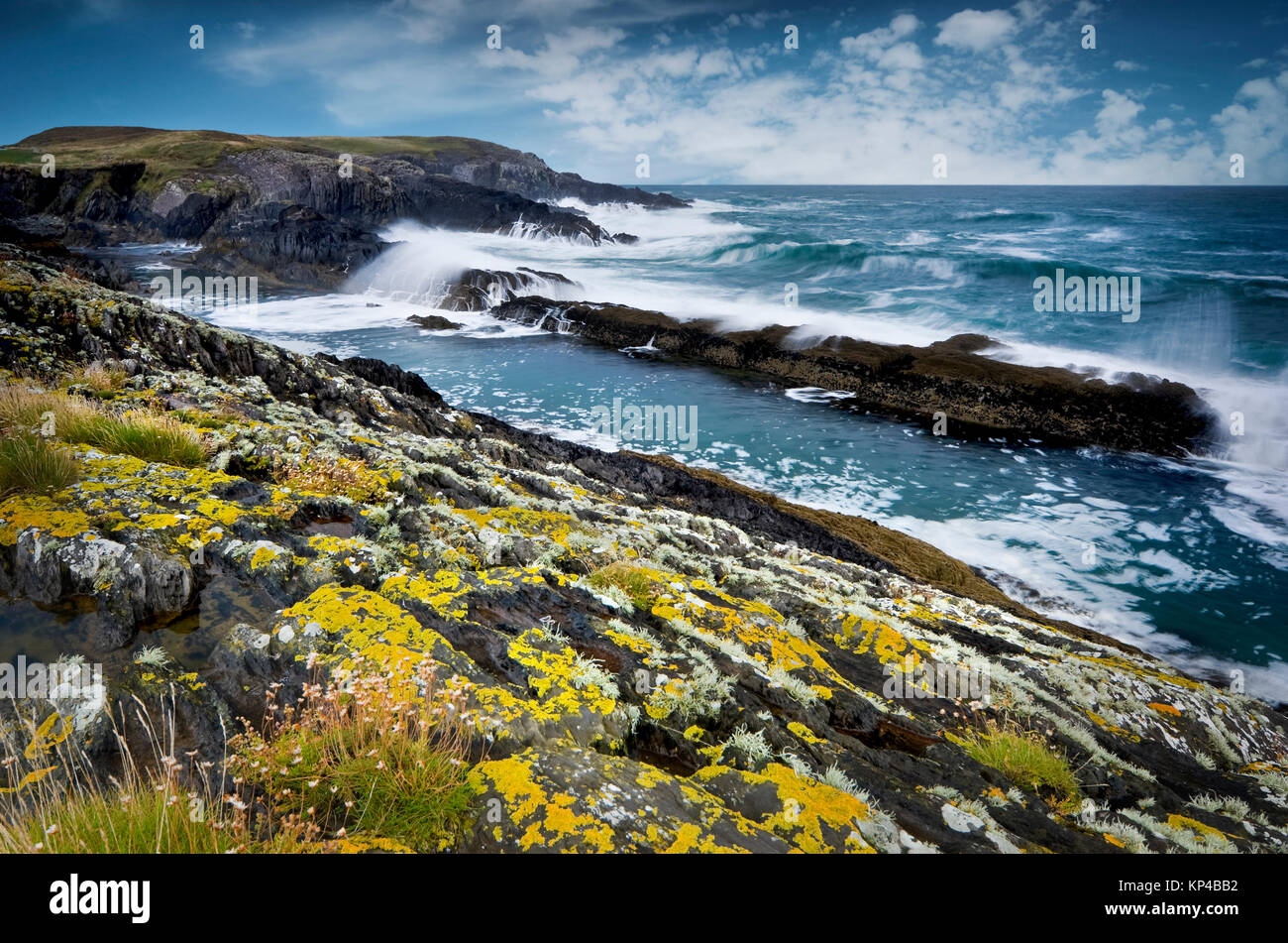 Rocky coast of Atlantic Ocean during stormy weather, South West of Ireland - Stock Image