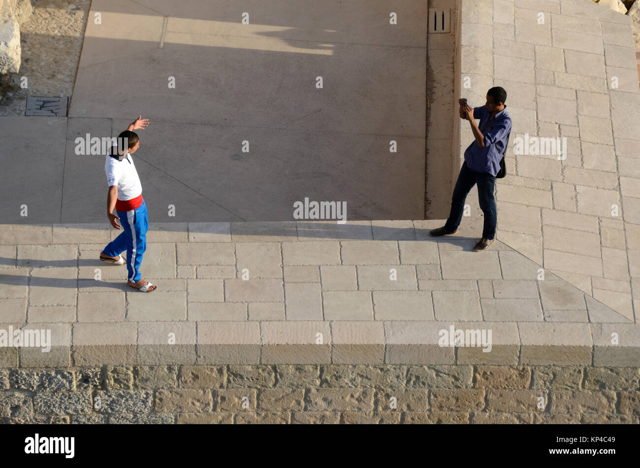 Local Youths Photographing Each Other on the Walls of Fort Saint Jean Marseille Provence france - Stock Image