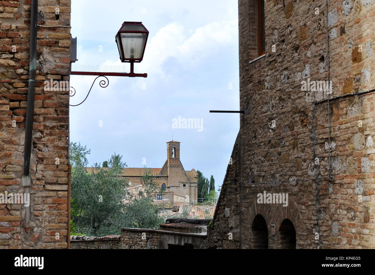 Stone and brick walls in the hill town of San Gimignano, Tuscany, Italy - Stock Image