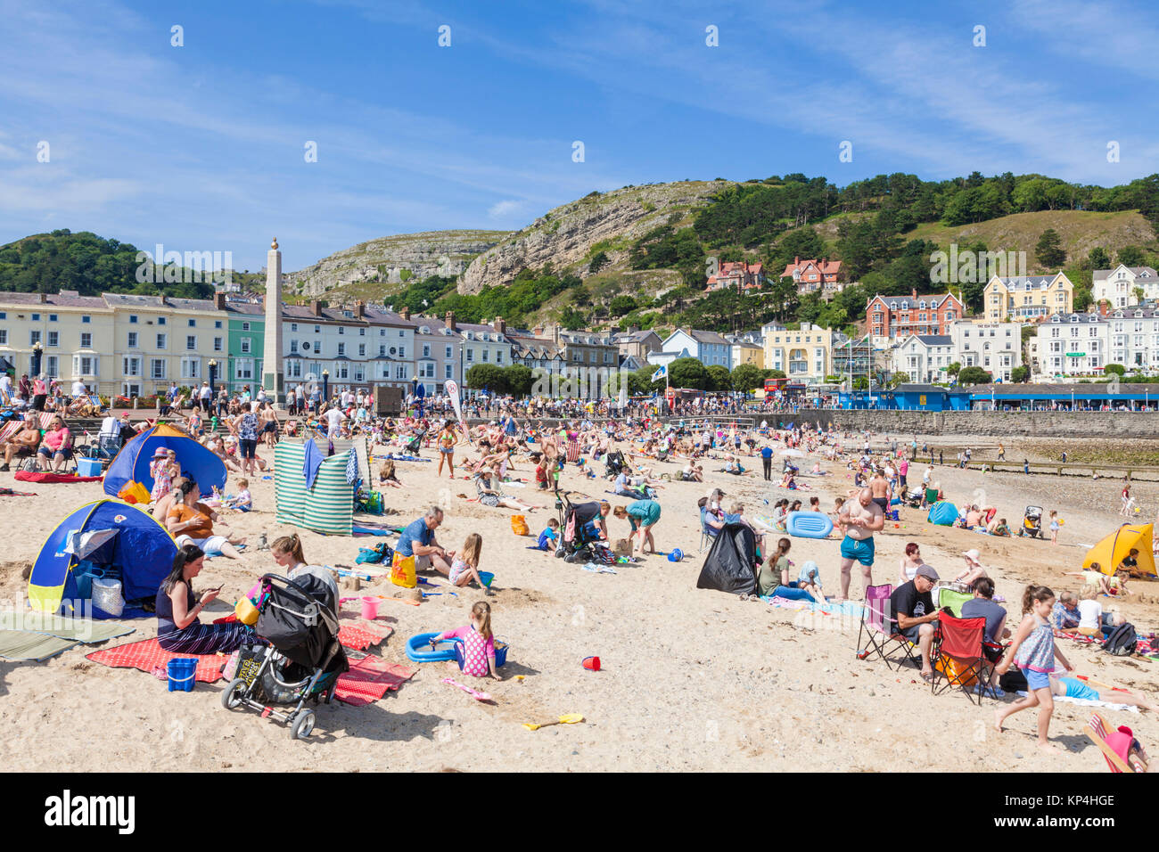 north wales llandudno north wales Llandudno beach holidaymakers adults and children playing on the beach Llandudno Stock Photo