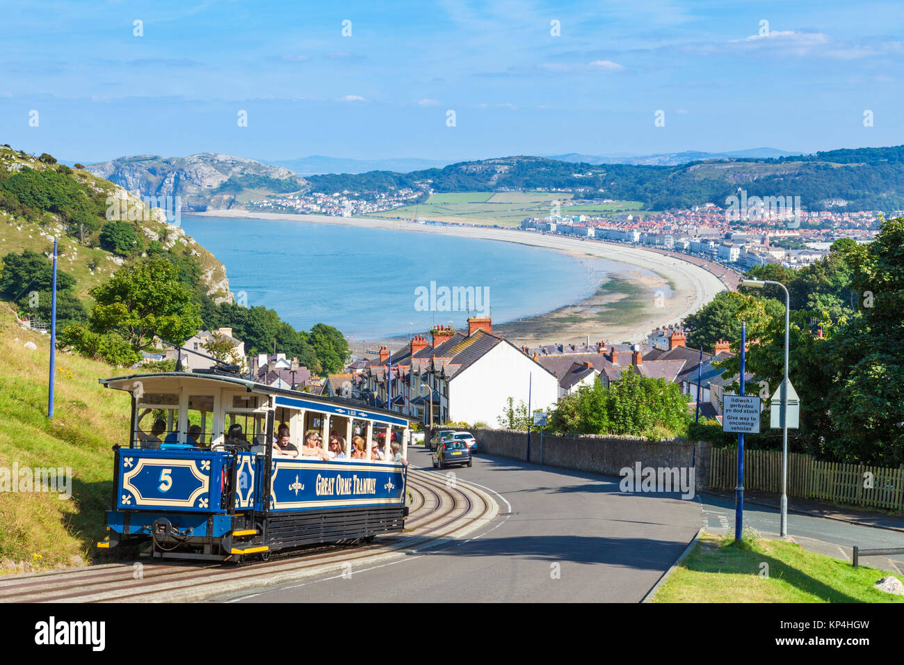 north wales llandudno north wales Llandudno view of Llandudno bay with tram train of the great orme tramway going Stock Photo