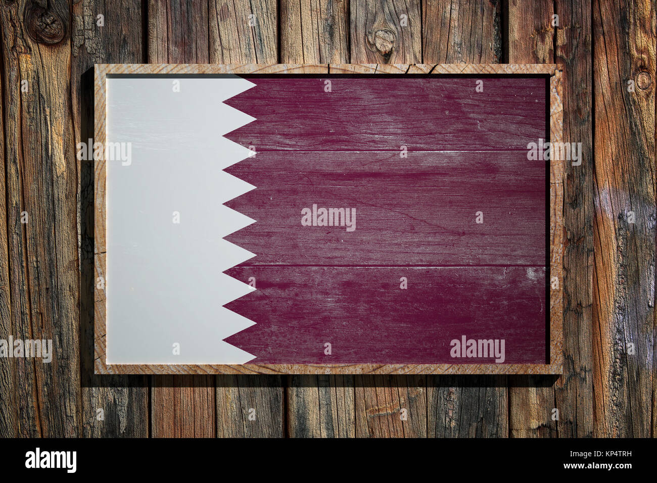 3d rendering of Qatar flag on a wooden frame over a planks wall ...