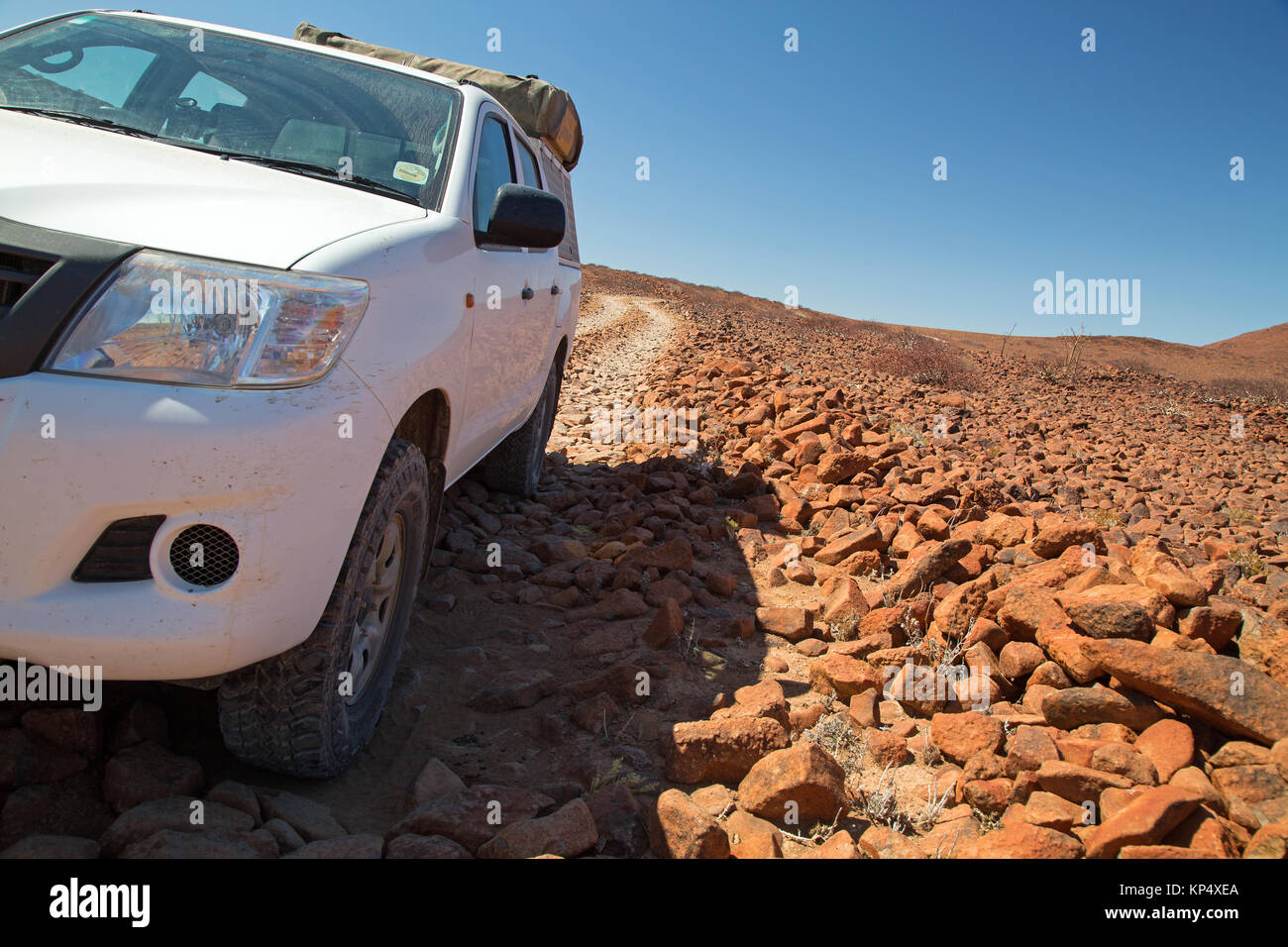 red landscape with jeep in damaraland Namibia - Stock Image
