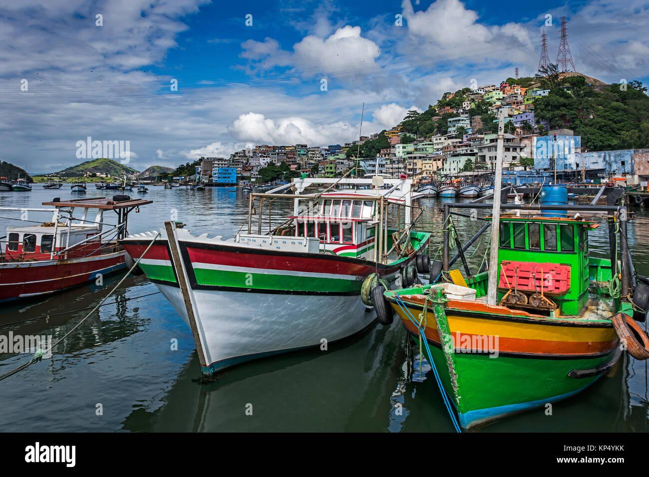Colorful fishing boats in the Pier of Praia do Sua, Vitoria, Espirito Santo State, Brazil. - Stock Image