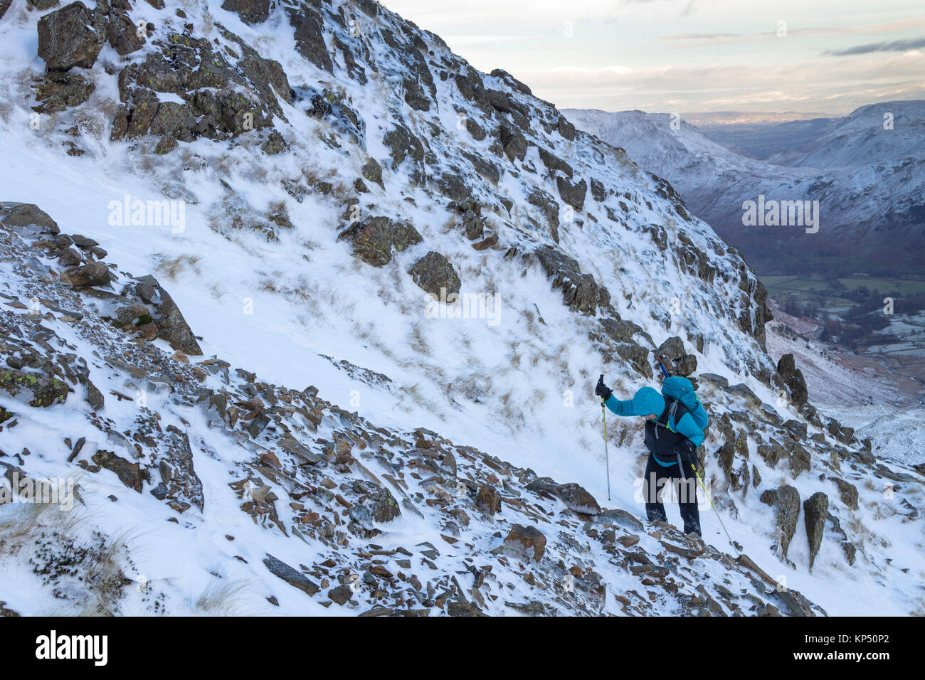 Hill Walker Making Their Way up onto the Mountain of Hart Crag From Hartsop Above How with Boredale Hause Behind, - Stock Image