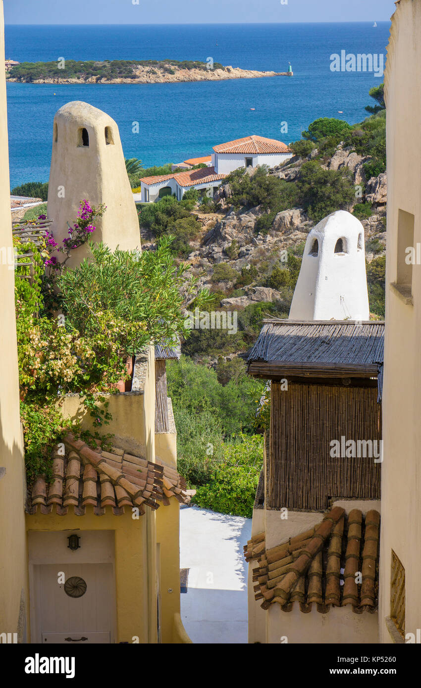 View between houses entrance of the Marina, Yacht harbour of Porto Cervo, luxury destination at Costa Smeralda, Stock Photo