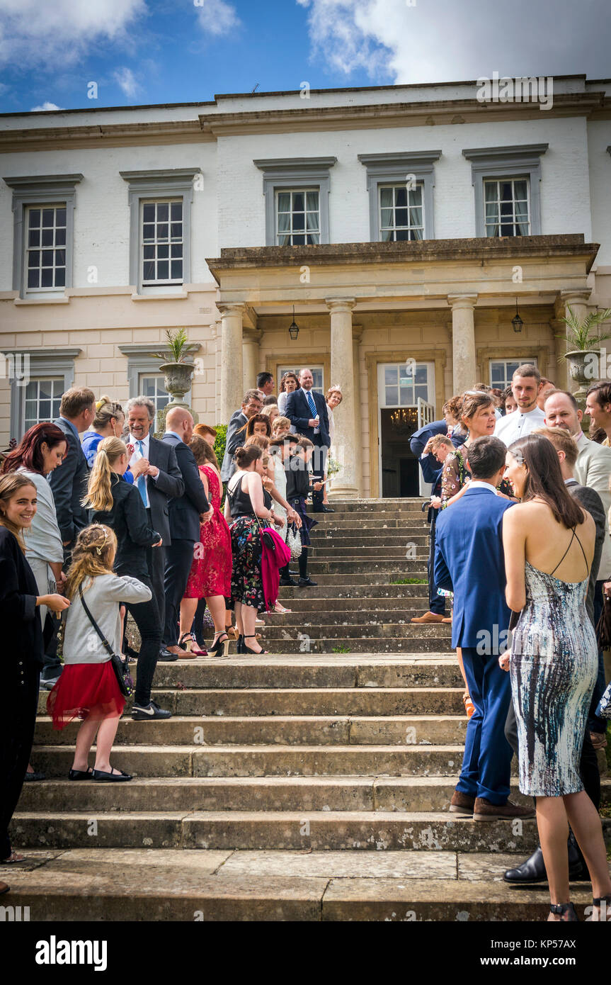Waiting to throw confetti for the Bride and Groom at an English wedding - Stock Image