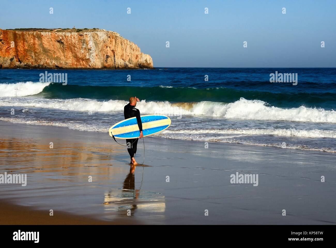 Europe, Portugal, Southern Portugal , Algarve region , Faro district , Sagres, Mareta beach - Praia da Mareta , single male surfer with surfboard Stock Photo