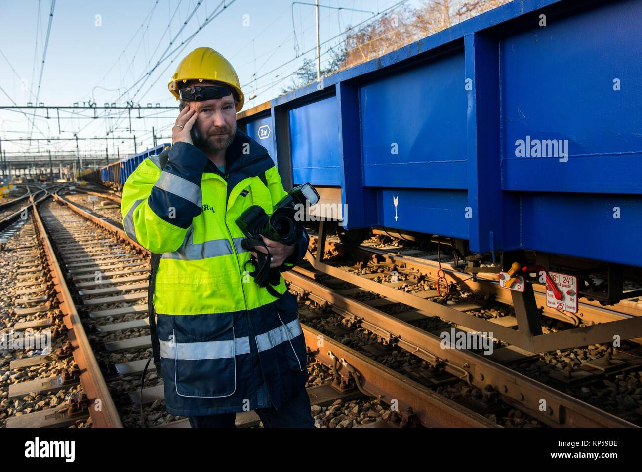 Rotterdam, Netherlands. Male spokesman of ProRail railway infrastructure corporation checking up on major overhaul - Stock Image