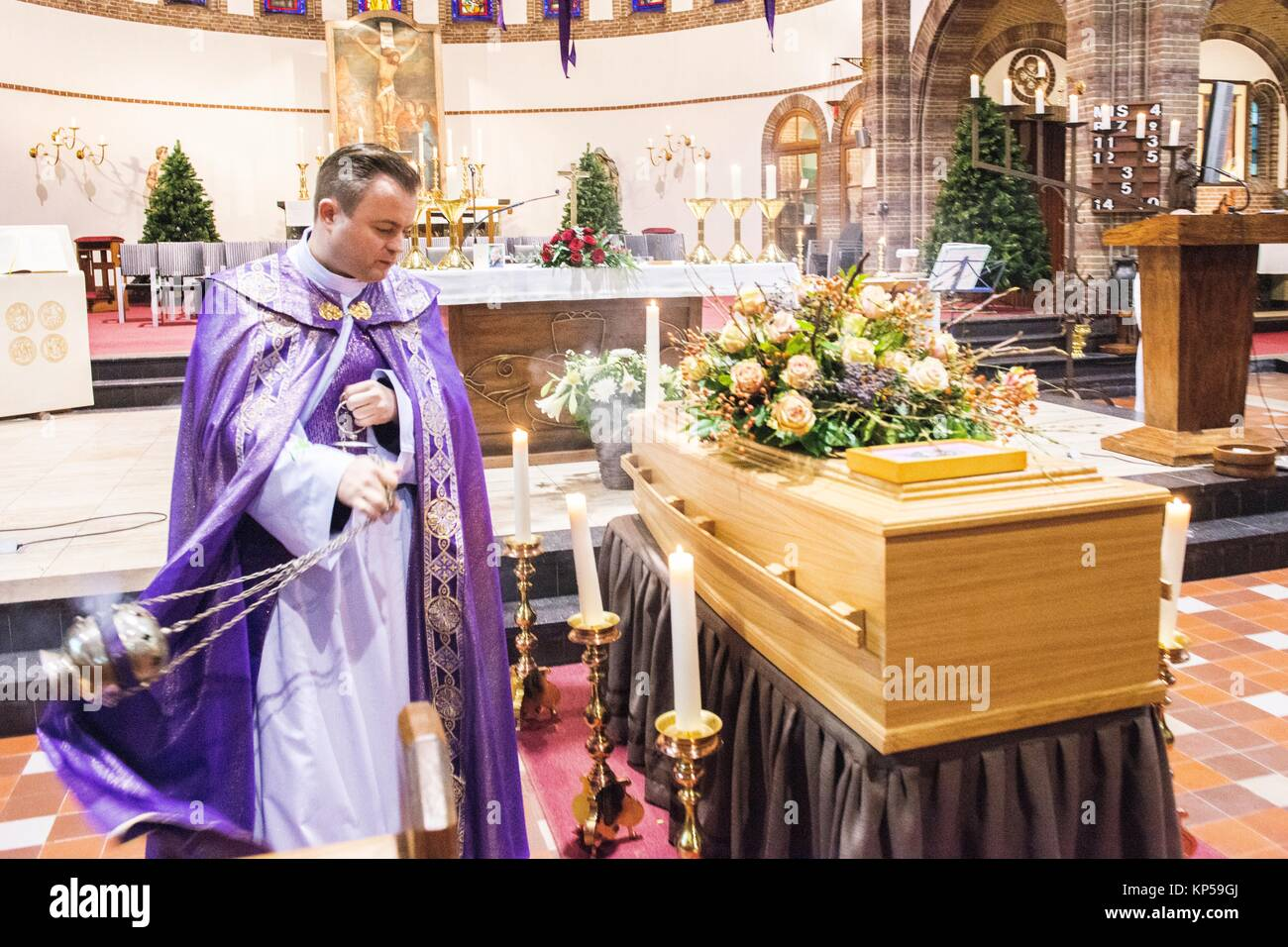 Catholic funeral stock photos catholic funeral stock images alamy catholic funeral ceremony prior to the burrial of a deceased person izmirmasajfo