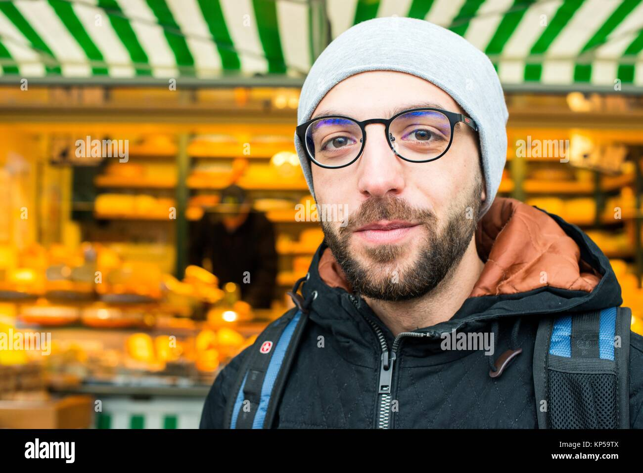 Tilburg, Netherlands. Former Syrian refugee visiting a Dutch market cheese stall at the weekly saturday market as - Stock Image