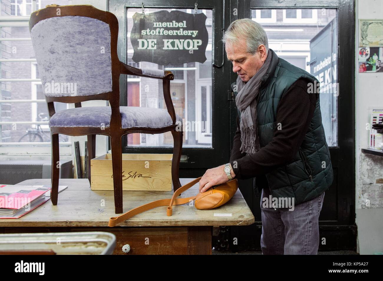 Tilburg, Netherlands. The 75 year old upholsterer Boy packing his latest things before partially retiring and moving - Stock Image