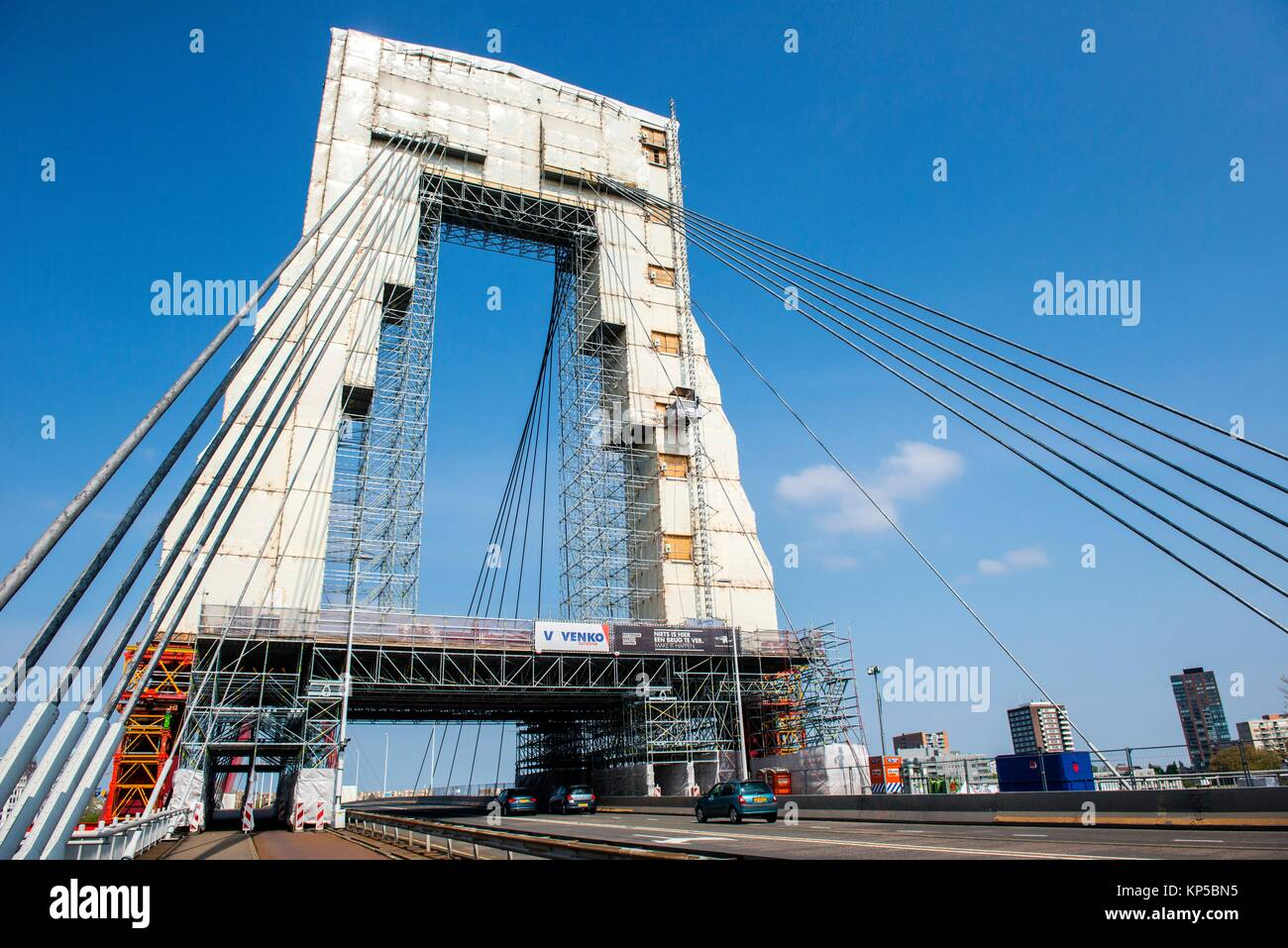 Rotterdam, Netherlands. The iconic Willemsbrug / Willems Bridge covered in protection during large, periodical maintenance Stock Photo