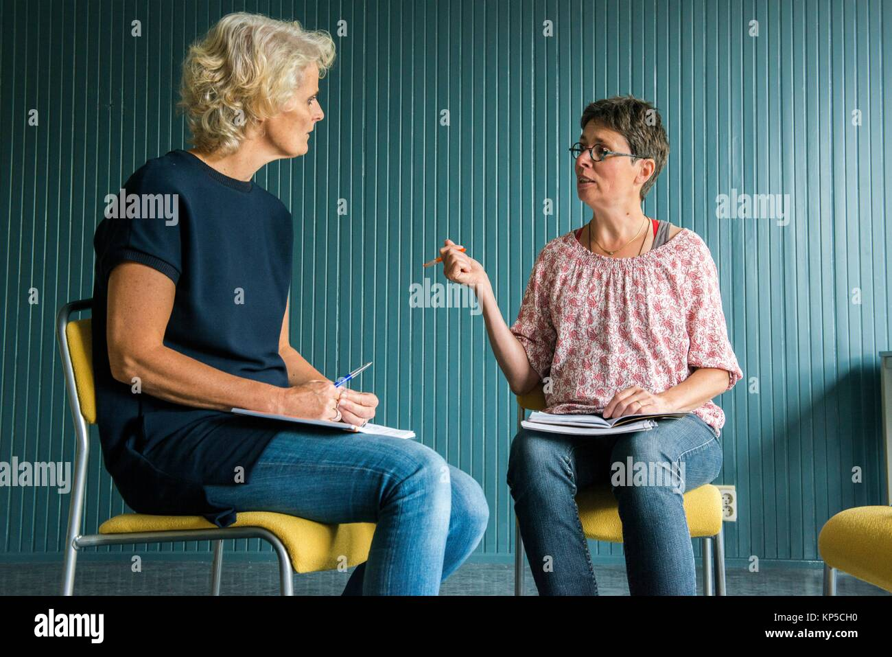 Tilburg, Netherlands. Mature adult woman having a coaching interview while searching for a new job and occupation. - Stock Image