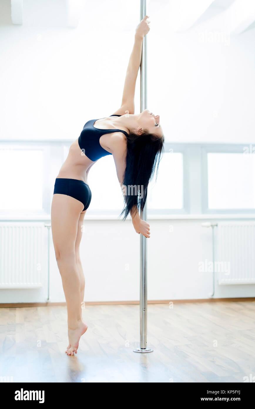 Poledance - pole dance - Stock Image