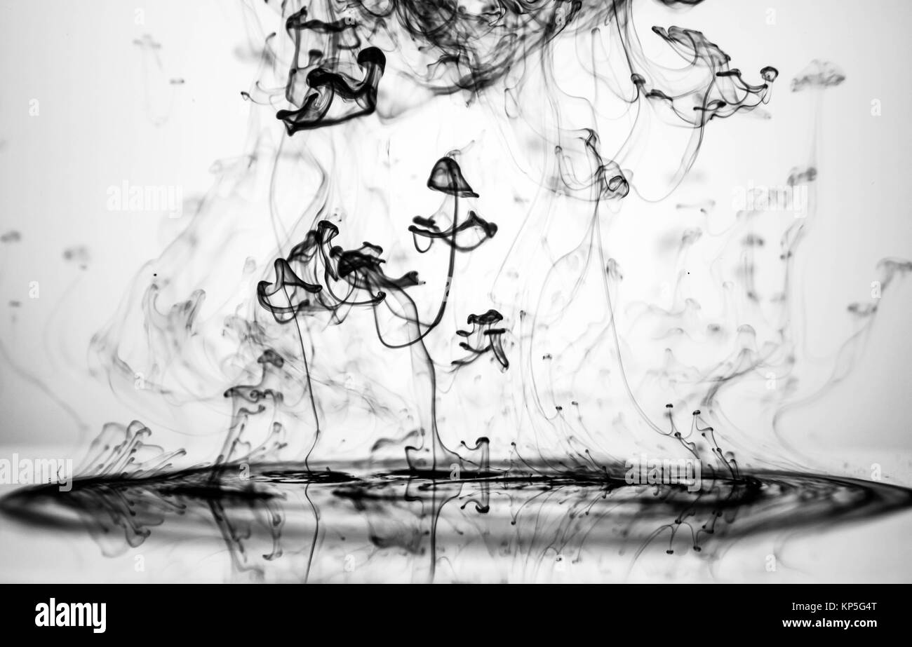 Ink in the water, inverted image. Stock Photo