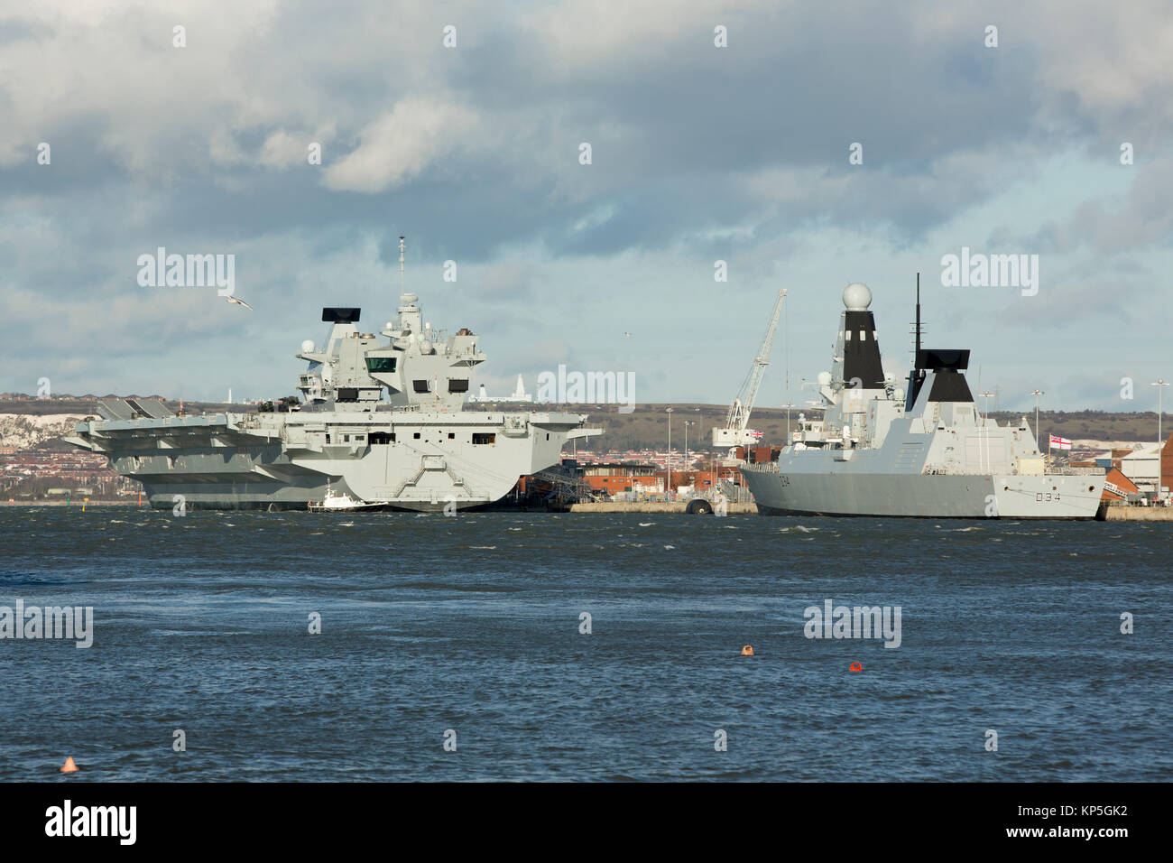 Royal Naval ships alongside in HMNB Portsmouth. Aircraft carrier HMS Queen Elizabeth and Destroyer HMS Diamond seen - Stock Image