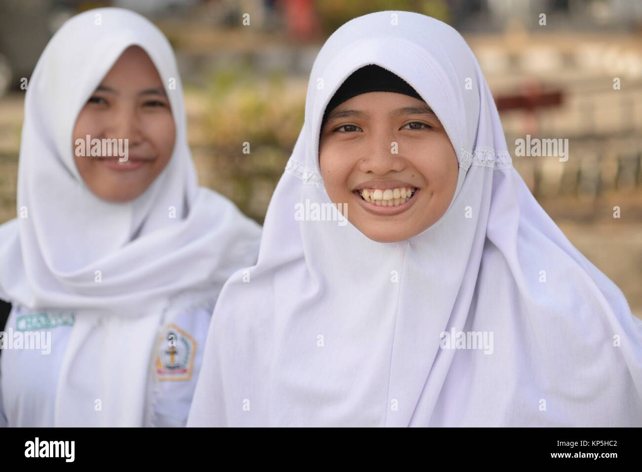 Portrait of a smiling muslim girl at Makassar,(formerly Ujung Pandang), Sulawesi island,Indonesia. - Stock Image