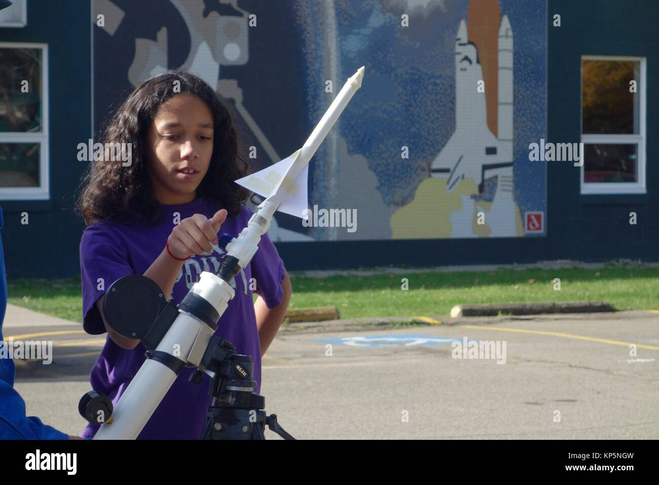 6th Grade Girl Preparing to Launch Paper Rocket, Challenger Learning Center, Allegany, New York, United States. - Stock Image